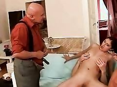 Three guys fucking and pissing on a girl